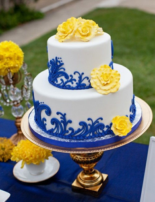I Just Adore The Design On This Wedding Cake With Royal Blue Swirls And Bright Yellow Sugar Flowers
