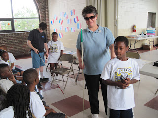 Laurel teaches sighted guide to summer day campers