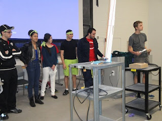 The green team presenting their bridge to the judges.
