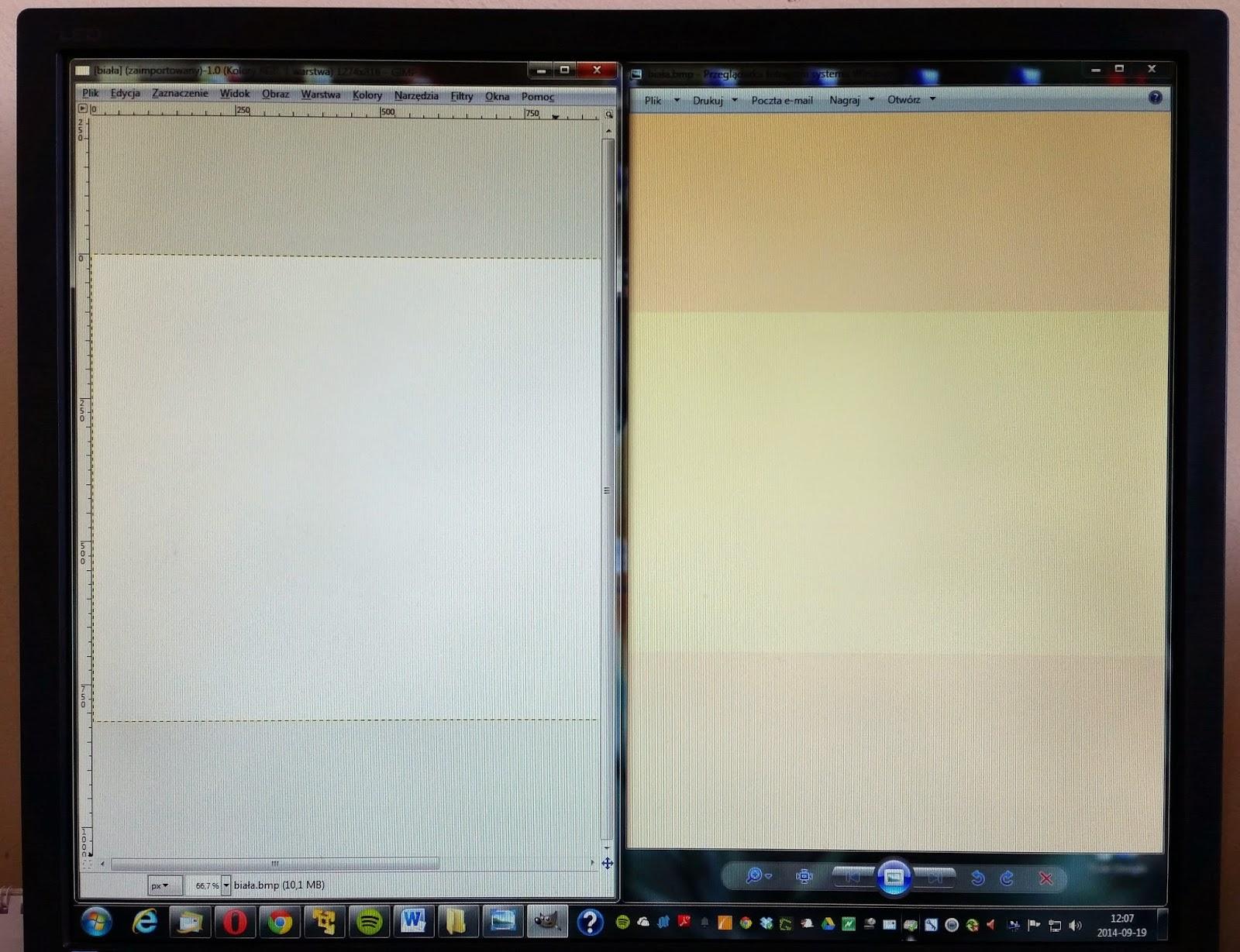 Zdjęcie monitora z programem Gimp po lewej i Przeglądarką fotografii Systemu Windows po prawej stronie