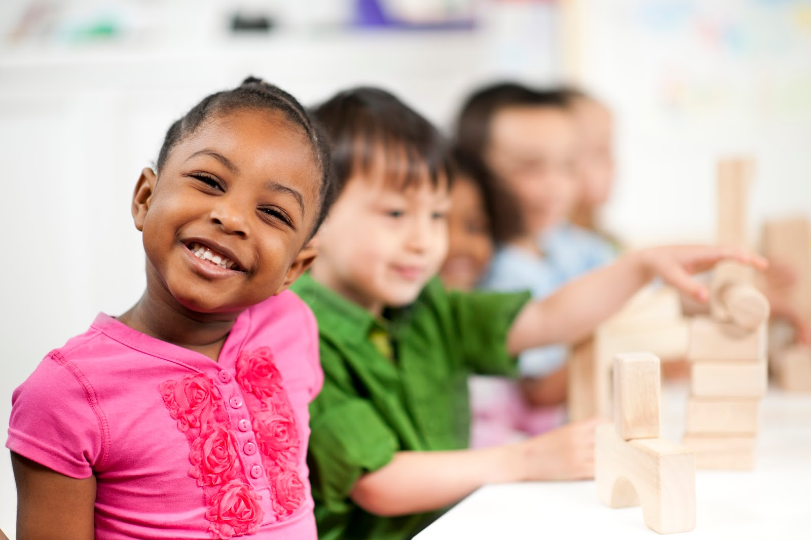 NAMC Montessori Twenty Years girl smiling in class