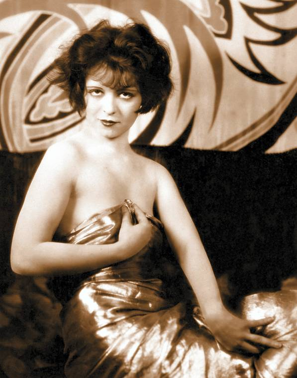 http://4.bp.blogspot.com/--JAf2Km37hk/URa6aHo7mOI/AAAAAAAAX-0/C1NEyYLcuZc/s1600/photo-movie-star-clara-bow-wrapped-in-metallic-sheen-cloth-looking-into-camera-hands-posed.jpg
