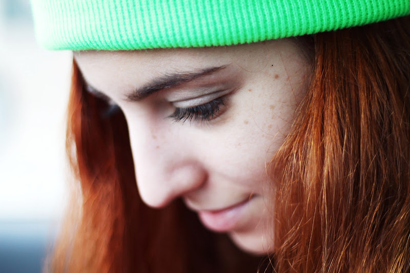 close up red hair, freckles and neon beanie
