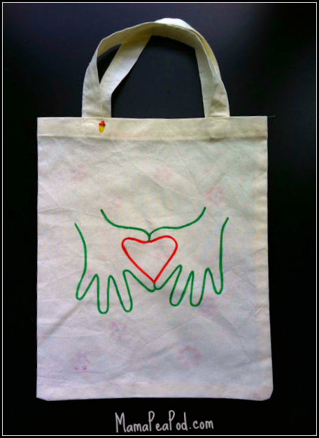 canvas bag with child's hands and heart for mothers day