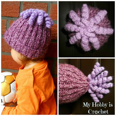 Crochet hat with curlie cue embellishment