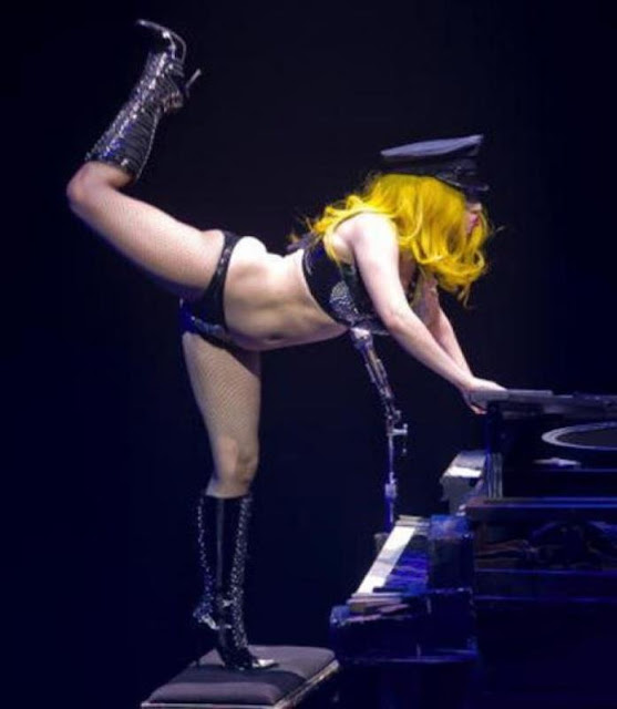Lady Gaga on a stool playing Piano