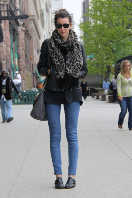 Roosevelt University in Chicago Student, Clementine, wears a pair of black Ray Ban sunglasses, a leopard print scarf and blue jeggings.