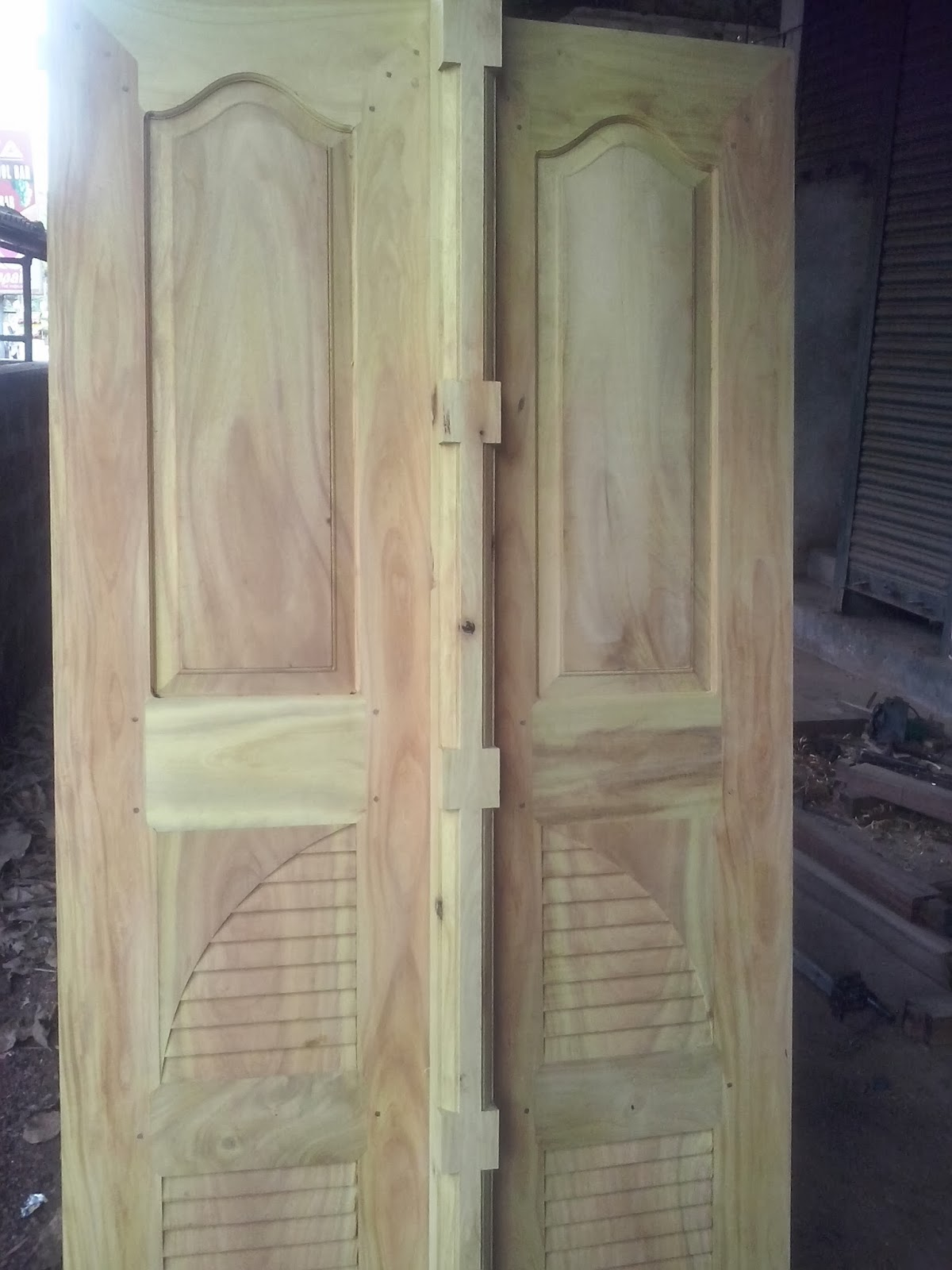 Bavas wood works main entrance wooden double door designs for Wooden door designs for houses