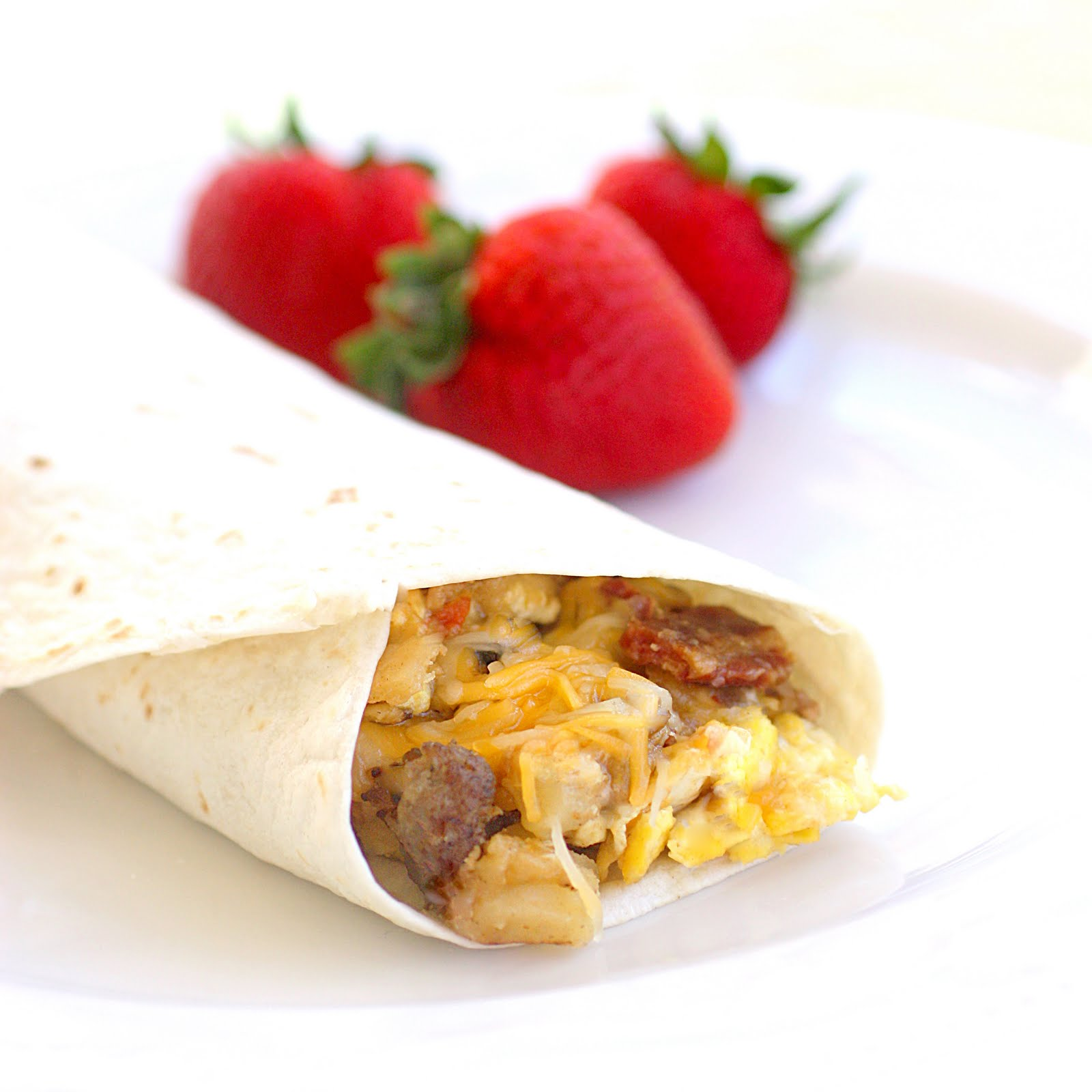 sausage and egg breakfast burritos with bacon and cheese