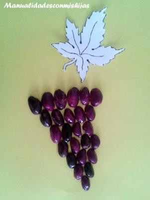 Racimo de uvas con cáscaras de pistachos con pintauñas