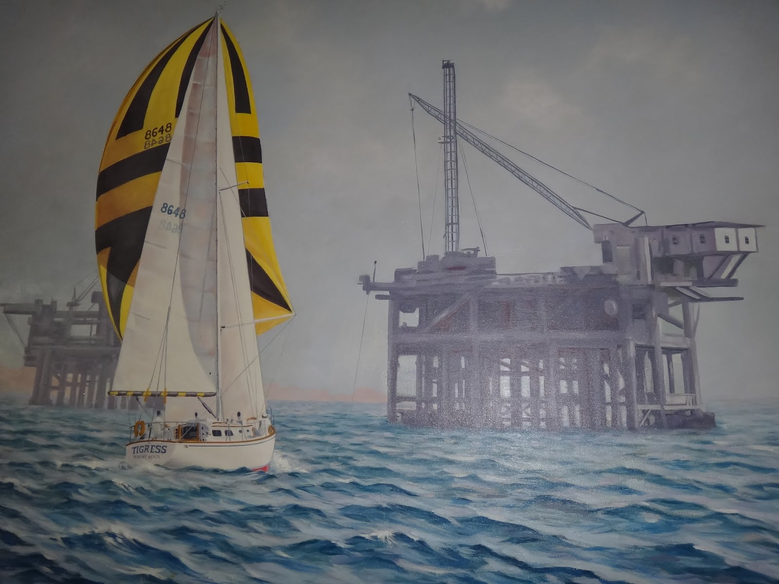 "... Gil Knudsen's 38 foot sloop ""Tigress"" approaching the oil platforms off ..."