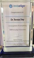 Dr Teresa receives award from Invisalign rep Sandy