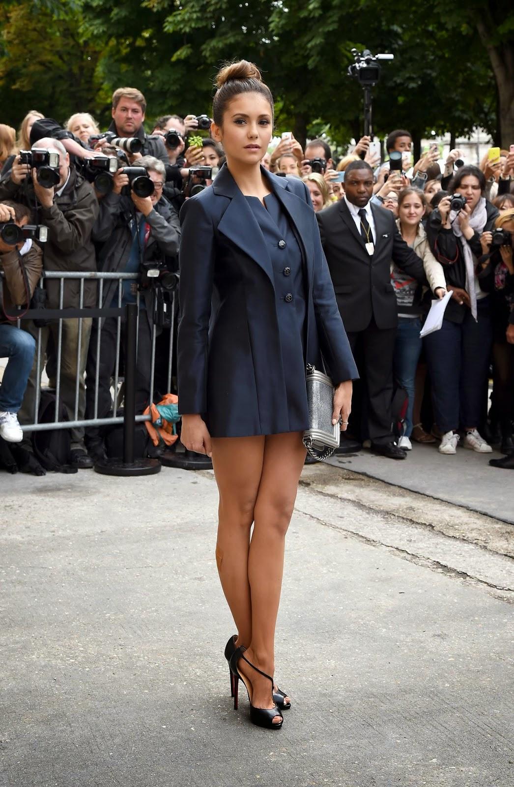 Nina Dobrev in a tuxedo inspired dress at the Chanel Fall ...