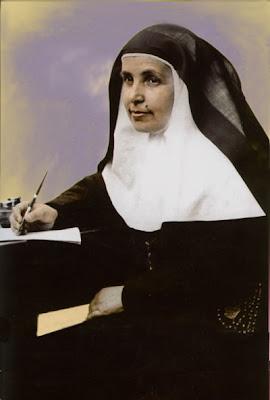 Santa Angela vestida de monja escribiendo