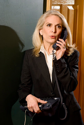 Catherine Russel answers the phone in the Old New York production of Perfect Crime