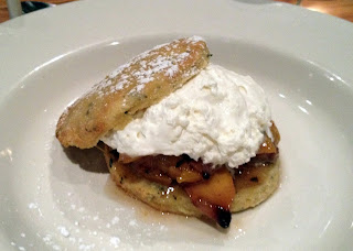 Bourbon Roasted Peaches with Whipped Cream on a Biscuit
