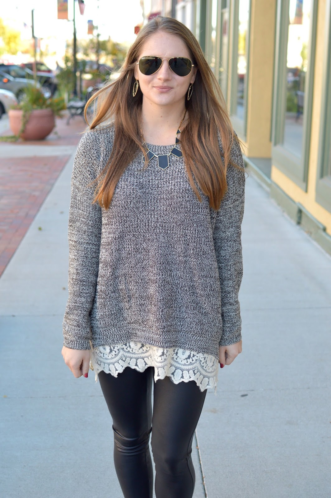 grey sweater with lace trim over leggings