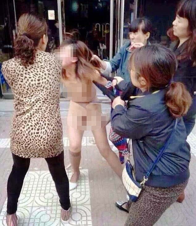 Chinese 'Adulteress' Is Stripped Naked And Beaten
