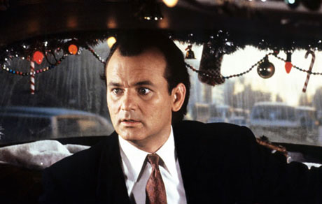 Bill Murray in a taxi with a surprised look on his face in Scrooged 1988 movieloversreviews.blogspot.com