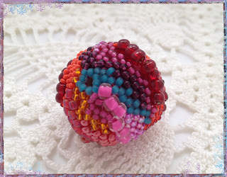 Quinacridone Summer, freeform peyote beaded bead by artist Karen Williams