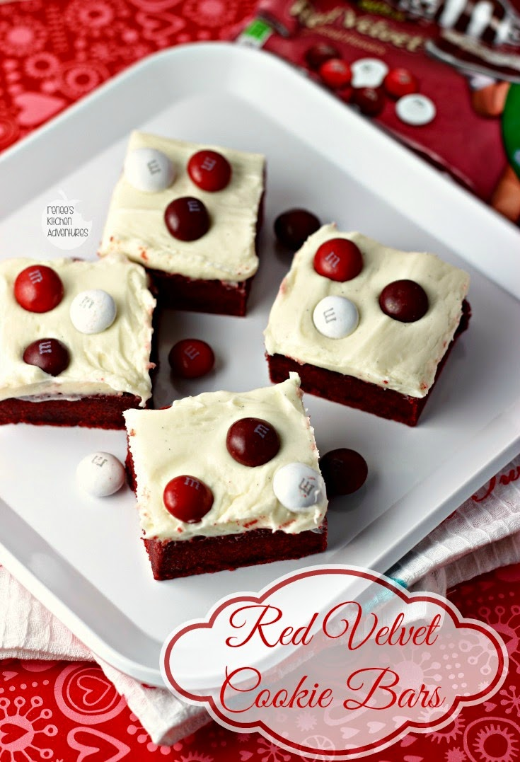 Red Velvet Cookie Bars | Renee's Kitchen Adventures: Brownie-like bars topped with cream cheese frosting and topped with M&M's® #RedVelvetLove #ad