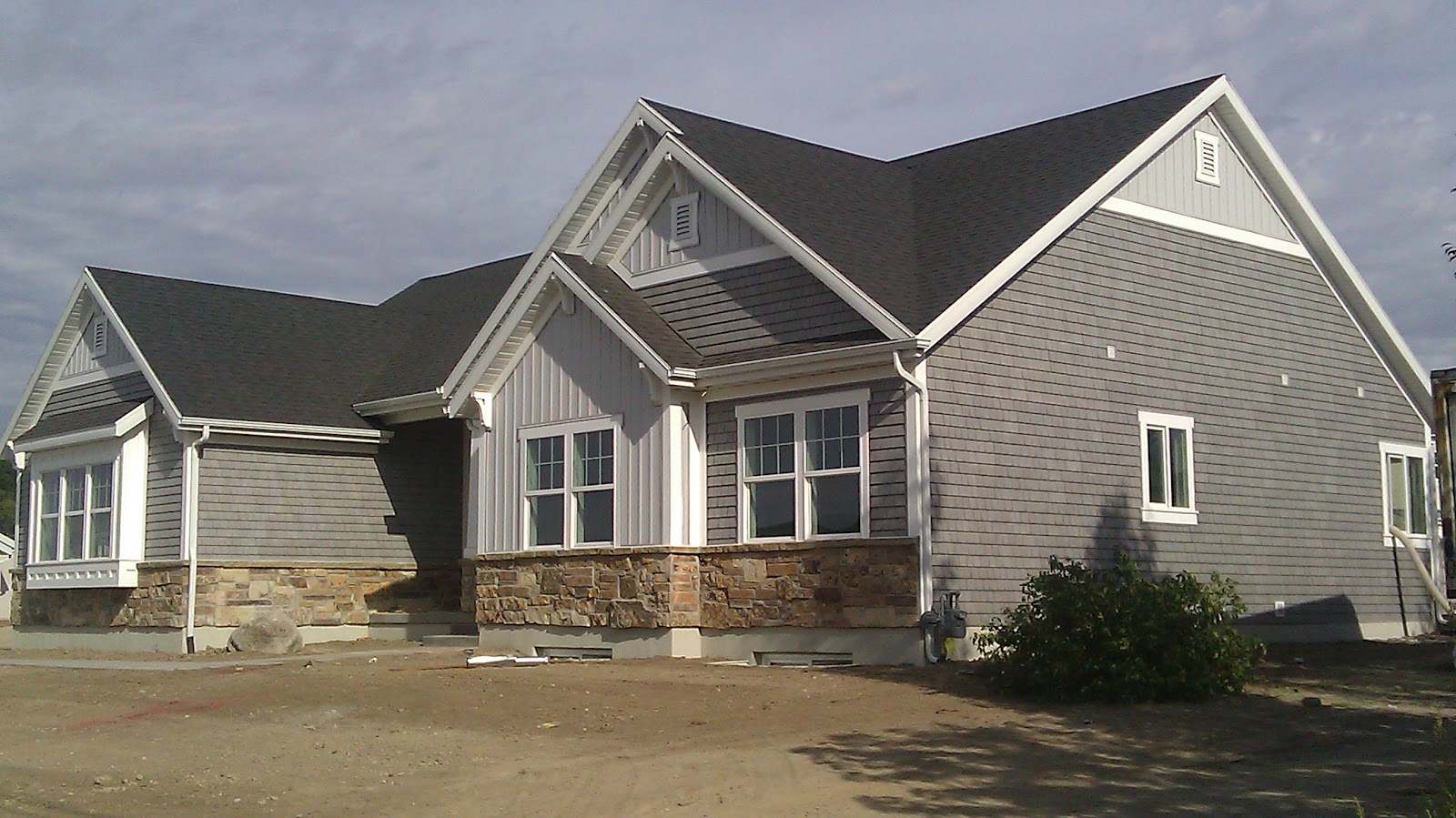 Stucco tech september 2012 for Stucco homes with stone accents