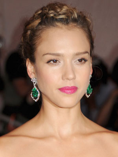 Jessica Alba flaunts an elegant updo with a delicate halo of braids on top.