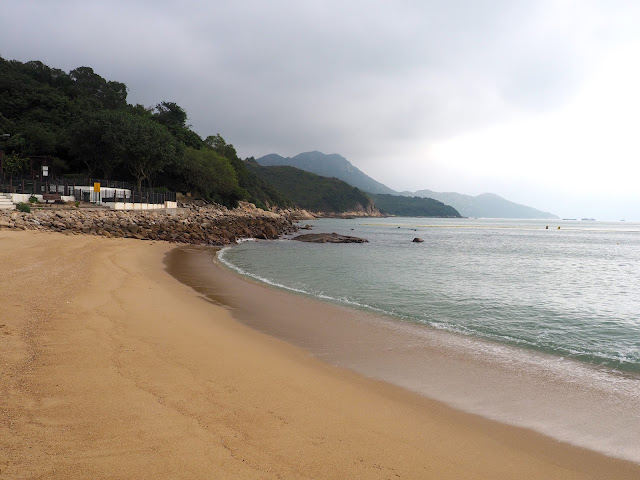Waves lapping on the sand at Hung Shing Yeh beach, Lamma Island, Hong Kong