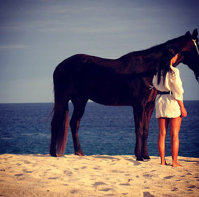 Kim-Kardashian-Goes-Horseback-Riding-in-Sexy-Beach-Dress