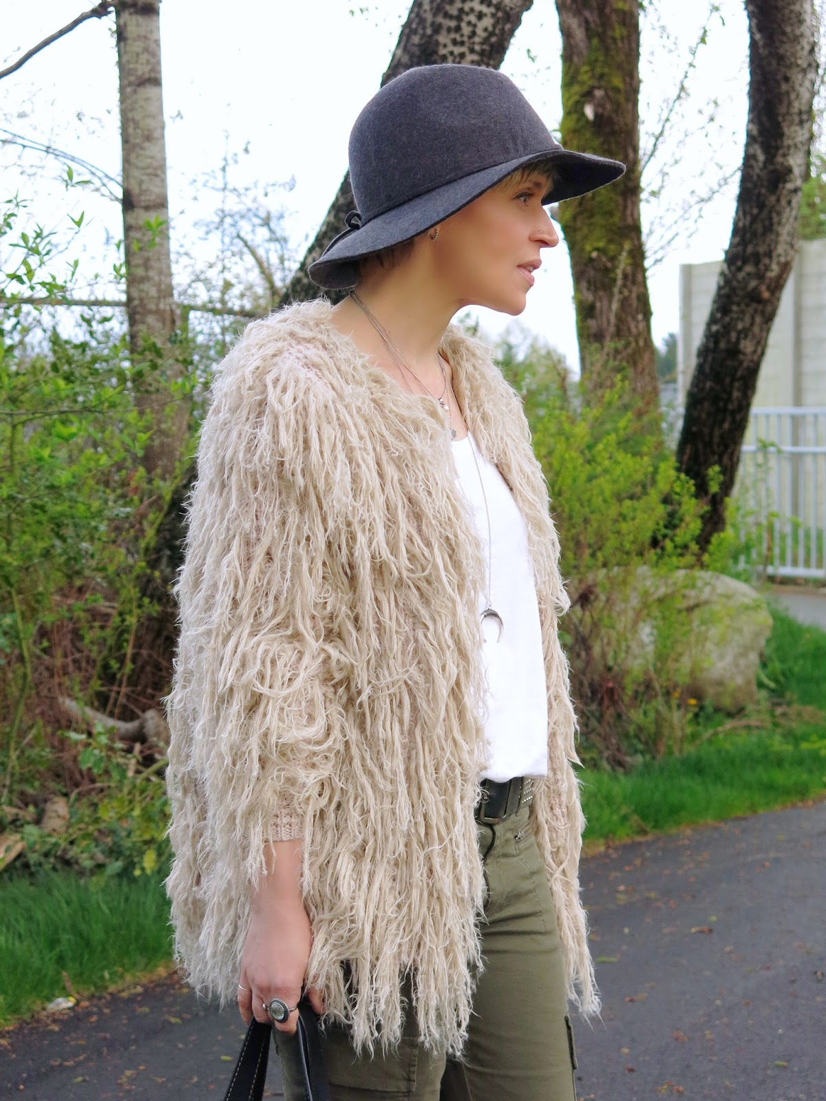 shaggy Free People cardigan and a floppy hat