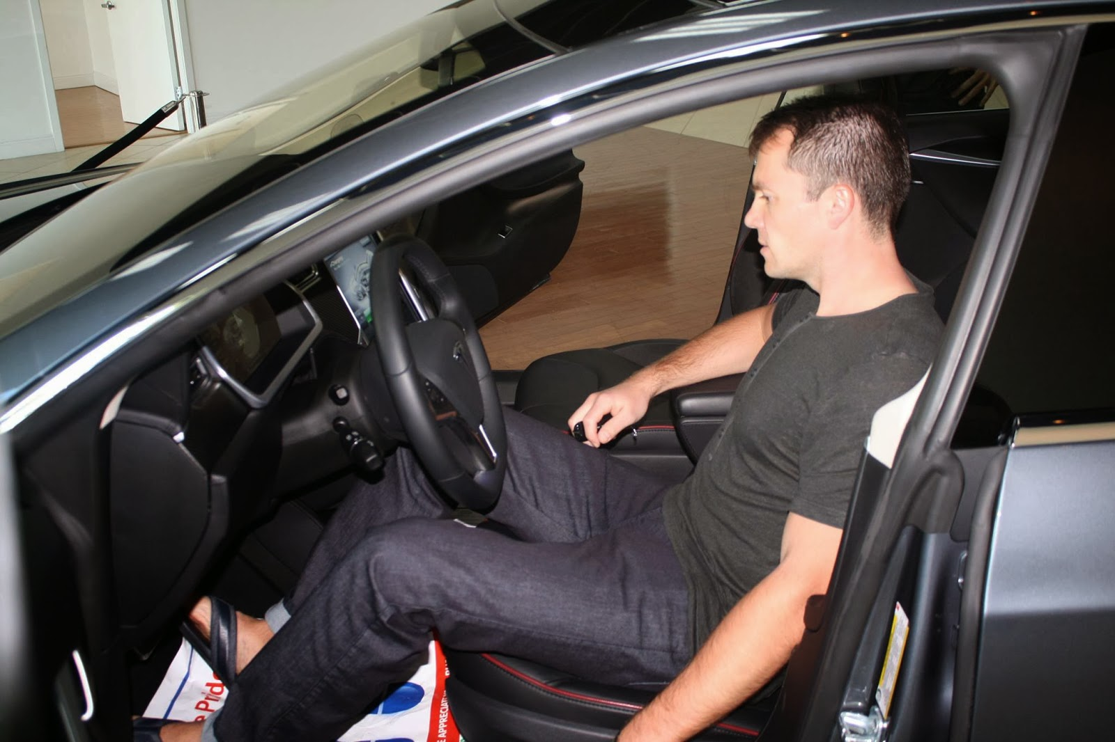 Vick Strizheus in his brand new Tesla Motors S