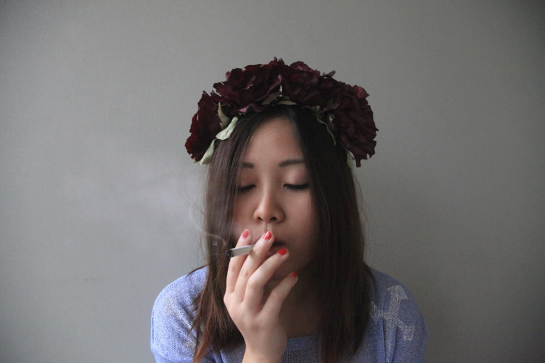 Anthea smoke cigarette and wears flower crown on epique