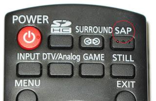 foto de parte de um controle remoto; em evidência a tecla SAP