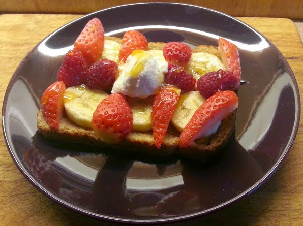 Fresh fruit and berries, ricotta and honey on toast