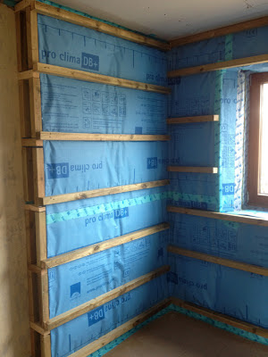 Airtightness/Vapour control layer complete around the internal insulation.  Battens to hold plasterboard and create void through which electric cables can be fitted.
