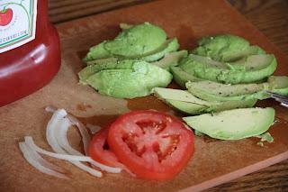 onions, tomato, avocado on a cutting board