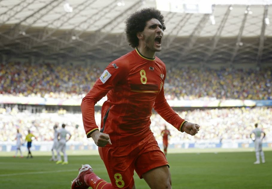 Belgium's Marouane Fellaini celebrates after scoring his side's first goal during the group H World Cup soccer match between Belgium and Algeria at the Mineirao Stadium in Belo Horizonte, Brazil, Tuesday, June 17, 2014.