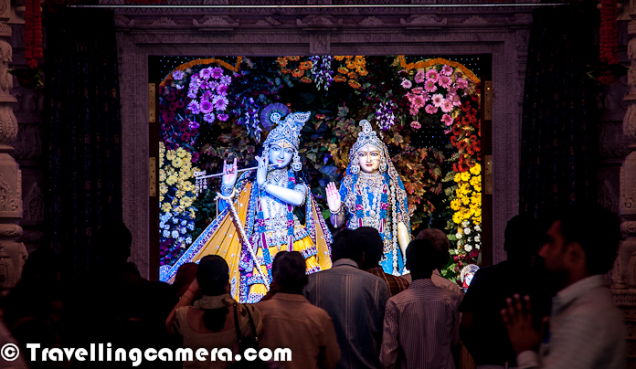 Few days back we shared a Photo Journey about Prem Mandir in Vrindavan. Prem Mandir is really a beautiful place in vrindavan and looks more like a tourist spot rather than a spiritual place, which doesn't mean that temple has less spiritual value. Prem Mandir is one of the most popular temples in Virndavan and this Photo Journey will show it's interiors.Here is a photograph of Prem Mandir in vrindavan with huge lawns all around and colorful spaces, which are well maintained. Above photograph shows a man working in lush green lawn and trying to ensure that plants are in good shape.This is how various statues are carved in various marble pillars and Walls of Prem Mandir in Vrindavan. From a distance, most of them look real and specially the ones with lot of people in one creation having 3D effect because of different placementsLord Krishna, who takes the main place inside Prem Temple of Vrindavan. This Statue of Lord Krishna is just in front of main gate of Prem Mandir...  This whole area looks amazing with wonderful lighting all around !!Here is a view of Lord Krishna and Radha-Rani statues from main entry gate of Prem Mandir !!! Inside the temple, paths are properly marked which guide everyone about the way they need to follow to have peaceful darshan of Lord Krishna/Radha on ground floor and Shri Ram/Sita on upper floor of the templeA closer look at the statues of Lord Krishna and Radha Rani with lot of people standing in front of them !Here is one of the marvelous creation carved out of marble rocks and looks real from distance. Each portion in these creations is placed very well to have 3D perspective from longer distances. This photograph is shot with a zoom lens otherwise it's not allowed to go closer to these creation, jut to maintain disciplineEach and every portion of Prem Temple at Vrindavan is quite vibrant and colorful. The whole campus is designed very well and maintained with same spiritHere is a photograph clicked from first floor, showing people sitti