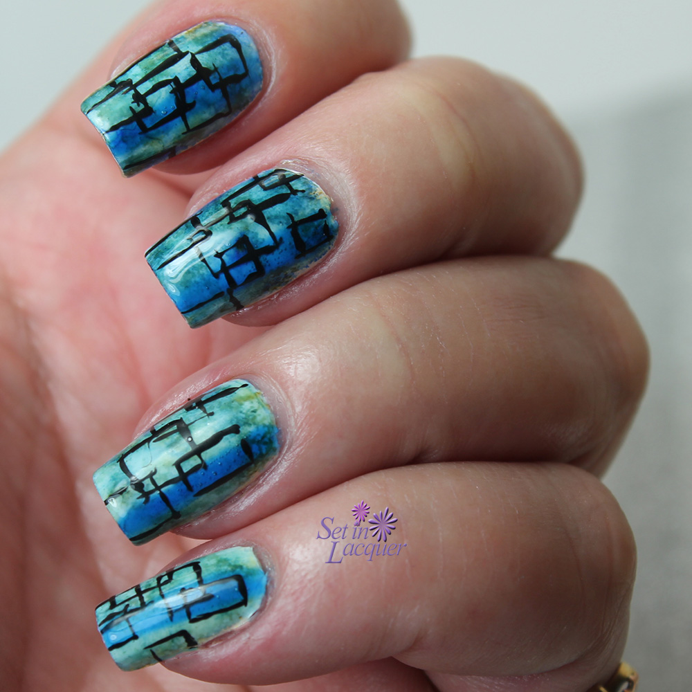 Random geometric over alcohol ink marble nail art