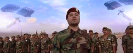 Members of the Syrian Arab Army sing a patriotic song. (Screen capture from YouTube video)
