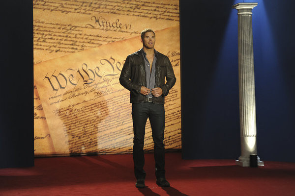 Kellan on stage with Constitution in background