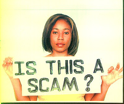 "Picture of a woman holding a sign up reading, ""Is this a scam?"""