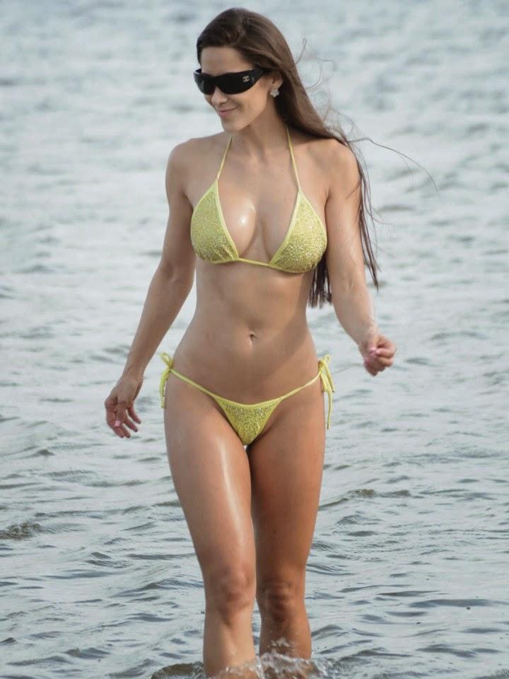 Anais Zanotti wears a yellow bikini at Miami on Thursday, April 17, 2014