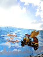 JANNAT KI SAWAARI - flying auto rickshaw mural by artist Hemant Sonawane taking a flight to heaven