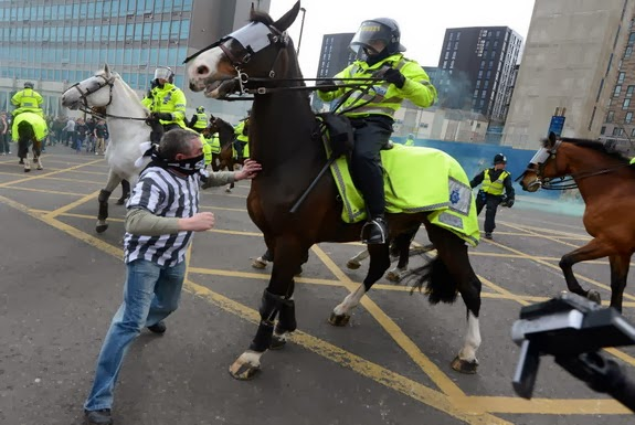 Newcastle fan Barry Rogerson is seen punching a police horse during a post-match riot