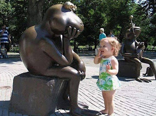 Cute adorable girl with Funny statues