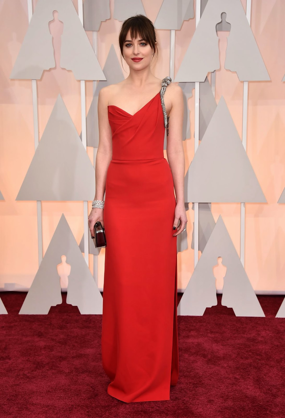 Dakota Johnson sizzles in a slinky red dress at the 2015 Oscars in Hollywood