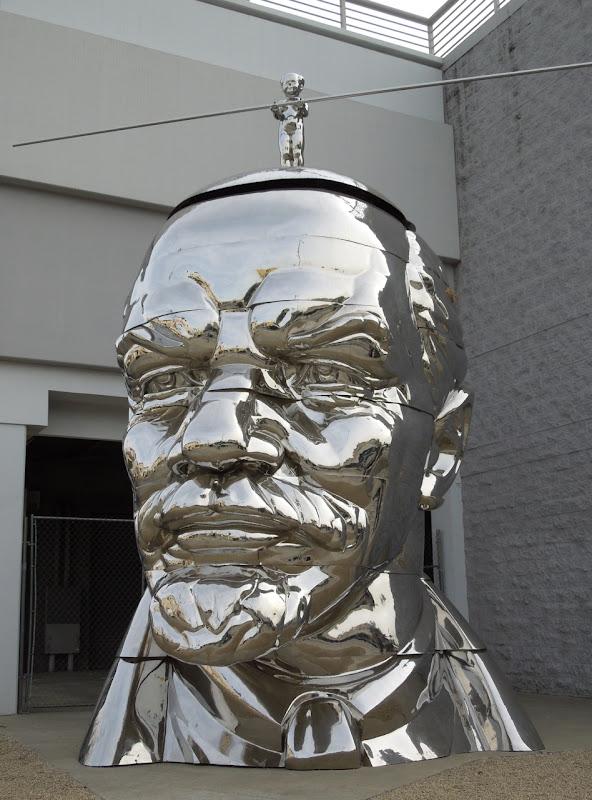 Giant Miss Mao Top of Lenin Head sculpture