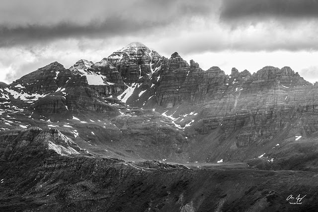 Black and white version of Castle peak with a fresh dusting of snow in the summer sunrise