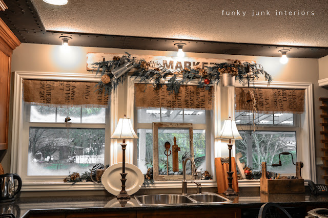 Christmas kitchen window decorating with old window picture, via Funky Junk Interiors